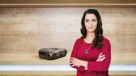 Mahbiz Hasheminia from Bosch stands in front of a shelf with vacuum cleaners.