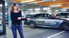 Standing in the parking garage of the Mercedes-Benz Museum in Stuttgart, Sabine Sayler points with both hands to a Mercedes emblazoned with the words Automated Valet Parking.